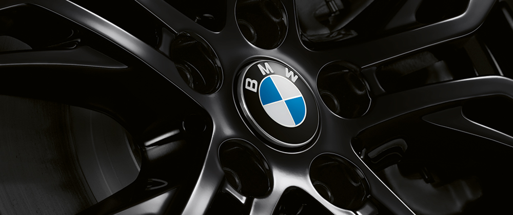 Close-up of a BMW Wheel featuring a BMW logo floating center cap.
